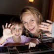 Mother and daughter talking in the Internet — Stock Photo