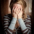 Ayoung woman took her hands face — Stock Photo #9193081
