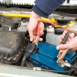 ������, ������: A mechanic using jumper cables