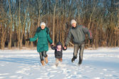 Family running in park — Stock Photo