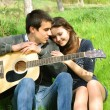 Loving couple with a guitar — Stock Photo