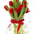 Royalty-Free Stock Photo: Red tulips in a vase with a red ribbon