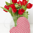 Red tulips tied with a red ribbon — Stock Photo