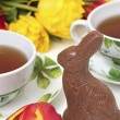 Royalty-Free Stock Photo: Easter chocolate bunny, tulips and tea
