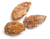 Fried almonds with sugar and cinnamon — Stock Photo
