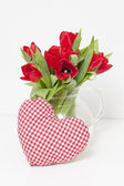 Tulips and heart-shaped pillow — Stock Photo