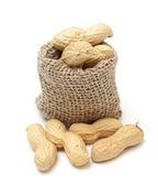 Peanuts in a miniature burlap sack — Zdjęcie stockowe