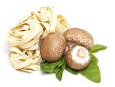 Italian pasta fettuccini and mushrooms — Stock Photo