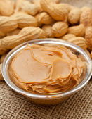 Peanut butter and peanuts — Stock Photo