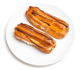 Two eclairs on a white plate — Stock Photo