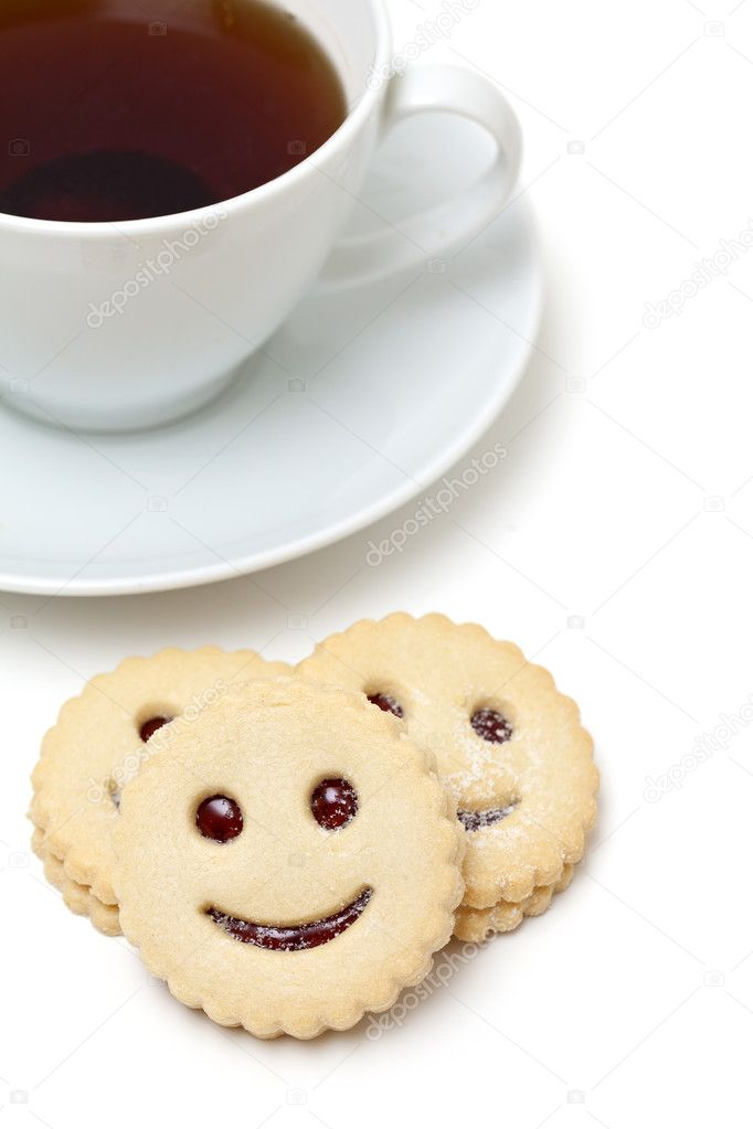 Cup of tea and smiling cookies over white — Stock Photo #9765597