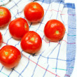Wet tomatoes on kitchen towel — Zdjęcie stockowe