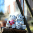 Teddy bear couple on a swing — Stock Photo