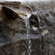 Closeup of water running from outdoor wall faucet — Stock Photo #9781198