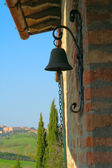 Colorful door bell with a wall of Tuscanian house — Stock Photo