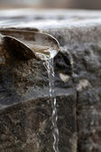 Closeup of water running from outdoor wall faucet — Stock Photo