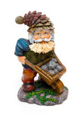 Colorful statue of a mountain worker with stones — Stock Photo