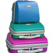 Three colorful suitcases - Stock Photo