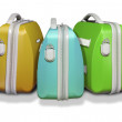 Three bright colored suitcases. — Stock Photo
