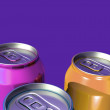 Three colorful drink cans — Stock Photo