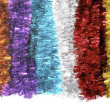 Christmas tinsel in bright colors - Stock Photo