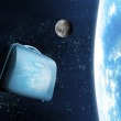 Suitcase floating in space - Stock Photo