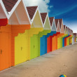 Beach huts on sand — Stock Photo