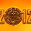 Mayan calander and 2012 text - Stock Photo
