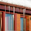 Icicles on house roof — Stock Photo #10256088