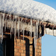 Icicles on house roof — Stock Photo #10256100