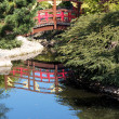 Japanese style bridge over pond — Stock Photo