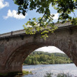Stone bridge over river - Stock Photo