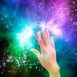 Stock Photo: Hand reaching for stars