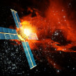 Damaged satallite and solar flares - Stock Photo