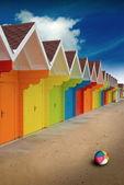 Beach huts on sand — Stock Photo