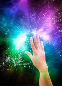 Hand reaching for the stars — Stock Photo