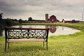 Farm and lake — Stock Photo