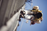 Climber on cell tower — Stock Photo