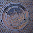 Stock Photo: Manhole cover seen in Charleston