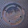 Manhole cover seen in Charleston - Stock Photo
