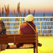 Two women seating on the bench - Corniche in Beirut — Stock Photo #9800208
