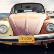 Orange Volkswagen Beetle seen in Taos, New Mexico — Stock Photo #9800639