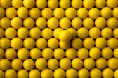 Yellow round pills background — Stock Photo