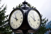 Street clock at Harrison lake resort, reminding owl face — Zdjęcie stockowe