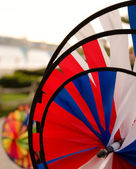 Red, blue and white wind spinners in Seaport village, San Diego — Stock Photo