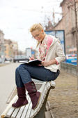 Girl on a bench. — Stock Photo