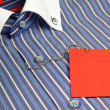 Shirt and red label — Stock Photo #9101860