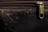 Horizontal leather background and fastener — Stock fotografie