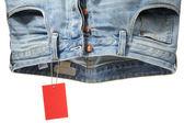 Pantalones de mezclilla y etiqueta — Foto de Stock