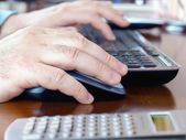 Man's hands on computer mouse and keyboard — Stockfoto